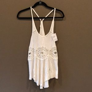 Free People white tank size S. Tags still on.